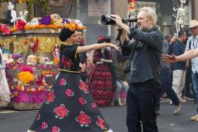 PARADE: Director Sam Mendes filming on location in Zocalo Square in Mexico City.