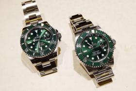 SPOT THE DIFFERENCE? The Rolex Submariner on the far left is a fake. Watch dealers say the differences with fakes these days are minute. In this case, there is a slight difference in the shade of the watch dial.