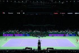 POWER DISPLAY: Maria Sharapova (left) extending her winning streak over Simona Halep (right) to 6-0 at the Singapore Indoor Stadium.