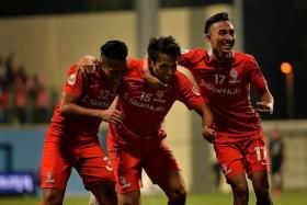 THREE TO THRILL: LionsXII's Sahil Suhaimi (far left) and Faris Ramli (near left) celebrating after Shahdan Sulaiman (centre) scored against Johor Darul Ta'zim II in their last match on Oct 17.