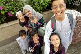 HAPPIER TIMES: Madam Nurul Asyikin Norman remembers how her husband, Mr Mohd Rizalludin Hassan, always doted on their children.