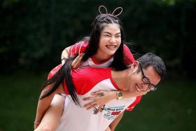 PURR-FECT TOGETHER: Mr Jason Lim with wife Ang Khana Phonasa.