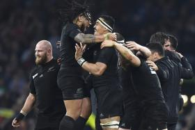 New Zealand players after winning their Rugby World Cup final match against Australia at Twickenham in London, Britain October 31, 2015.