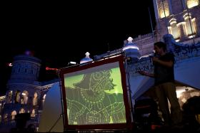 A Star Wars-inspired Wayang Kulit, a traditional shadow puppetry on a screen during a show at the Independence square in Kuala Lumpur.
