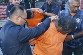 ARRESTED: Four members of a Malaysian family have been arrested (above) in relation to four murders, allegedly carried out in their home.