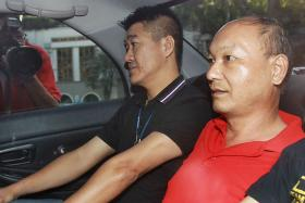 SENTENCED: Hu Ziqing (in red) was jailed 10 years for killing his wife.