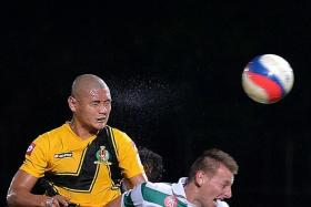 WASTED CHANCE: Shahrazen Said (in yellow) rises above Jozef Kaplan but fails to score with his header.