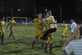 OVERJOYED: Tampines Rovers chairman Teo Hock Seng (in black pants) hugging Mustafic Fahrudin after sealing their 2011 league title by beating Home United 1-0 on a muddy pitch.