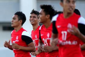 CALM BEFORE THE STORM: LionsXII star Safuwan Baharudin (second from left) is all smiles as he trains with his teammates yesterday