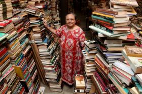 Mdm Yap Hui Hong, 65, is a retired teacher who sells used books which were bought by her husband in his youth. As he has passed on, she and her family started the bookstore to clear the books.