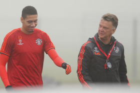 Manchester United defender Chris Smalling (left) and manager Louis Van Gaal outside Old Trafford.