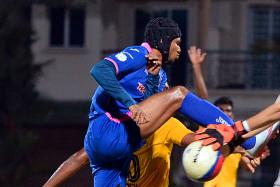 """""""All this while, I've been chasing Ramazotti. He started from the first game, so for me to catch up and even be in the running is good enough."""" - Warriors FC's Fazrul Nawaz (above, in blue)"""