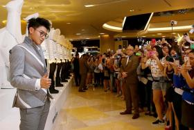 FERVENT: Over 600 fans of China-born idol Tao (in grey), who used to be in popular K-pop boyband EXO, showed up at Ion Orchard mall.