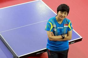 CASUALTIES: National women's coach Jing Junhong (above) was reassigned to coach the youth set-up while Yang Chuanning was sacked as national men's coach.