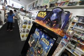 Customers shop for Star Wars collectibles at Meltdown Comics and Collectibles in Los Angeles last month