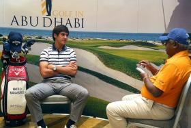 Matteo Manassero (left), in an interview with The New Paper's Godfrey Robert (right) in Abu Dhabi last Monday.