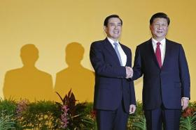 SUMMIT: Taiwan president Ma Ying-jeou (left) shaking hands with China president Xi Jinping.
