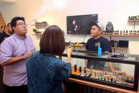 WORRYING: Customers at a vape store in Petaling Jaya. A crackdown on vape businesses in Johor selling nicotine products found drugs like marijuana, methamphetamine and ketum juice in vape liquids.