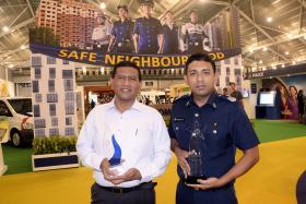 HONOURED: (Right) Assistant Superintendent Kamaruzaman Gaffar (left) and Senior Staff Sergeant Muhammad Nizam Khan Surattee with their awards.