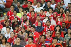 THEY'RE BARCA, NO, THEY'RE LIONSXII, NO, THEY'RE MAN UNITED, NO, THEY'RE SINGAPORE FANS! The sea of red cheering on the Lions against Japan at the National Stadium on Thursday.