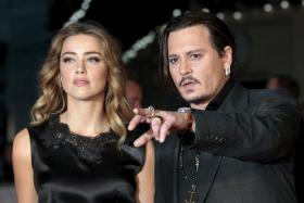 """Johnny Depp and his actress wife Amber Heard at the British premiere of the film """"Black Mass"""" in London."""