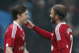 David Beckham was substituted by his son Brooklyn to rapturous applause during a charity match at Old Trafford on Saturday.