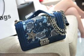 ANGRY: Miss Lee's YSL handbag (pink) was genuine but the one she exchanged for (blue) was not.