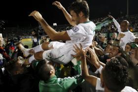 Raul Gonzalez celebrates winning the NASL with his New York Cosmos teammates.