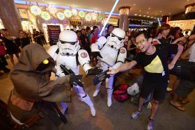 FANATICS: Mr Nicholas Ho (far right) showing his tickets to other Star Wars fans.