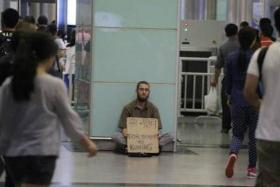 """Polish national """"Victor"""" has been seen at Guangzhou East Railway Station, begging for money for a train ticket to Kunming."""