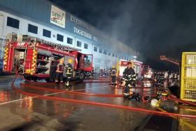 UNDER CONTROL: The fire in a contractors' office at Keppel Shipyard in Tuas is put out by the SCDF, which, on arrival, found the in-house Company Emergency Response Team already at work trying to put out the fire with five water jets.