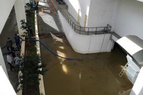 CLEAN-UP: Water being drained from the basement carpark at Komtar JBCC mall.