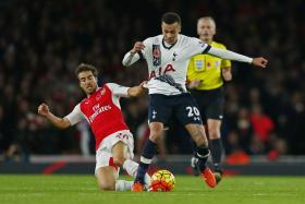 Arsenal midfielder Mathieu Flamini, seen here tackling Tottenham's Dele Alli, recently revealed that he stands to gain a fortune from a biochemical company that he co-founded.