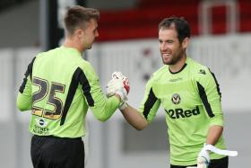 James Bitten (right) waited 13 years to play his first full game in the English Football League.