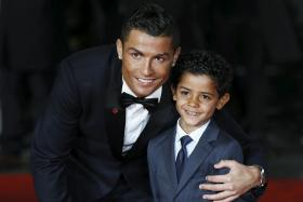 Ronaldo and his son Ronaldo Jr, 5,  pose on the red carpet at the world premiere of Ronaldo at Leicester Square in London