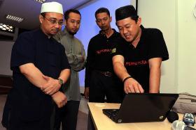 File photo of Mr Mohamad Fahmi Ahmad Rais (right).