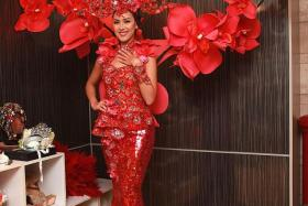ETHNIC-INSPIRED: Local couturier Frederick Lee designed the national costume for Miss Universe Singapore Lisa Marie White (above).