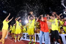 MISSING: Former Tampines chairman Teo Hock Seng (far left) will miss out on the celebrations should his team win the S.League tomorrow.
