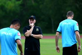 KEAN ON TITLE: Brunei DPMM coach Steve Kean (centre) believes his side will not let last season's late collapse play on their minds.