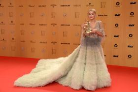 Rita Ora poses for photographers with her award at the Bambi awards on November 12, 2015 in Berlin.