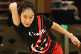 GOOD JOB: From sixth at the start of the round-robin stage yesterday, Singapore's Geraldine Ng (above) won half of her eight games to finish joint-fourth.