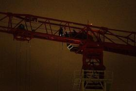 HELP: The tower crane operator had to be rescued by Dart officers.