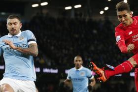 Roberto Firmino scores against Man City at the Etihad Stadium