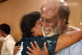 ELATED: Madam Sandanam gives Rajinikanth a hug and a kiss.