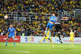 LIFELINE: Safuwan Baharudin (second from left) salvaging a crucial goal after beating Pahang goalkeeper Khairul Azhan Khalid to a long ball in the dying minutes.