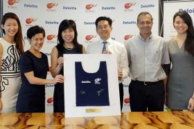 STRIKING A BALANCE: National netballers Charmaine Soh (far left) and Yu Mei Ling (far right) have benefited from Deloitte's supportive approach which helps athletes excel at work and sports.