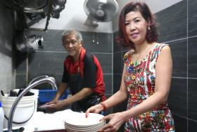 Ms Sharon Guan, 54, (right) defended one of her staff - dishwasher Mr Jimmy Wee, 53 - from an intolerant customer who complained about his skin condition.