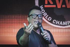 Singapore teacher Muhammad Fairus Adam performs at the Karaoke World Championships held in Singapore.