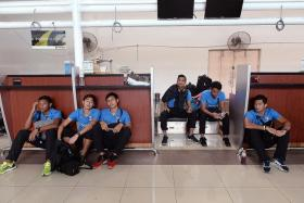 WHERE DO WE GO NOW? LionsXII players looking disconsolate while waiting for their flight back to Singapore at the Sultan Haji Ahmad Shah Airport in Kuantan yesterday.