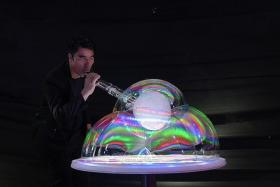FASCINATING: Yang's special bubble solution allows him to create fantastical shapes in his show.